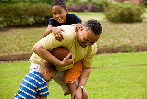 with a football twist pro sports image by www prosportsexperience comFamily Playing Sports Together